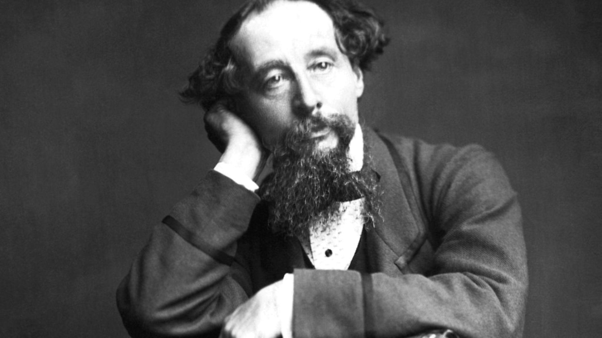 (Original Caption) Photograph of Charles Dickens (1812-1870) seated. Photo: Bettmann Archive - Credit: Bettmann Archive