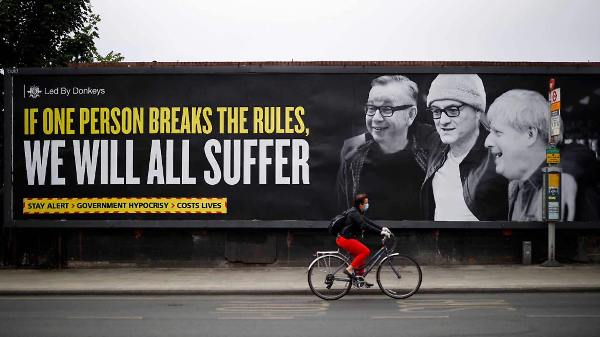 The billboard, exposing the government's hypocrisy over Dominic Cummings, was posted by political campaign group 'Led By Donkeys' in Kentish Town. Photo by TOLGA AKMEN/AFP via Getty Images - Credit: AFP via Getty Images