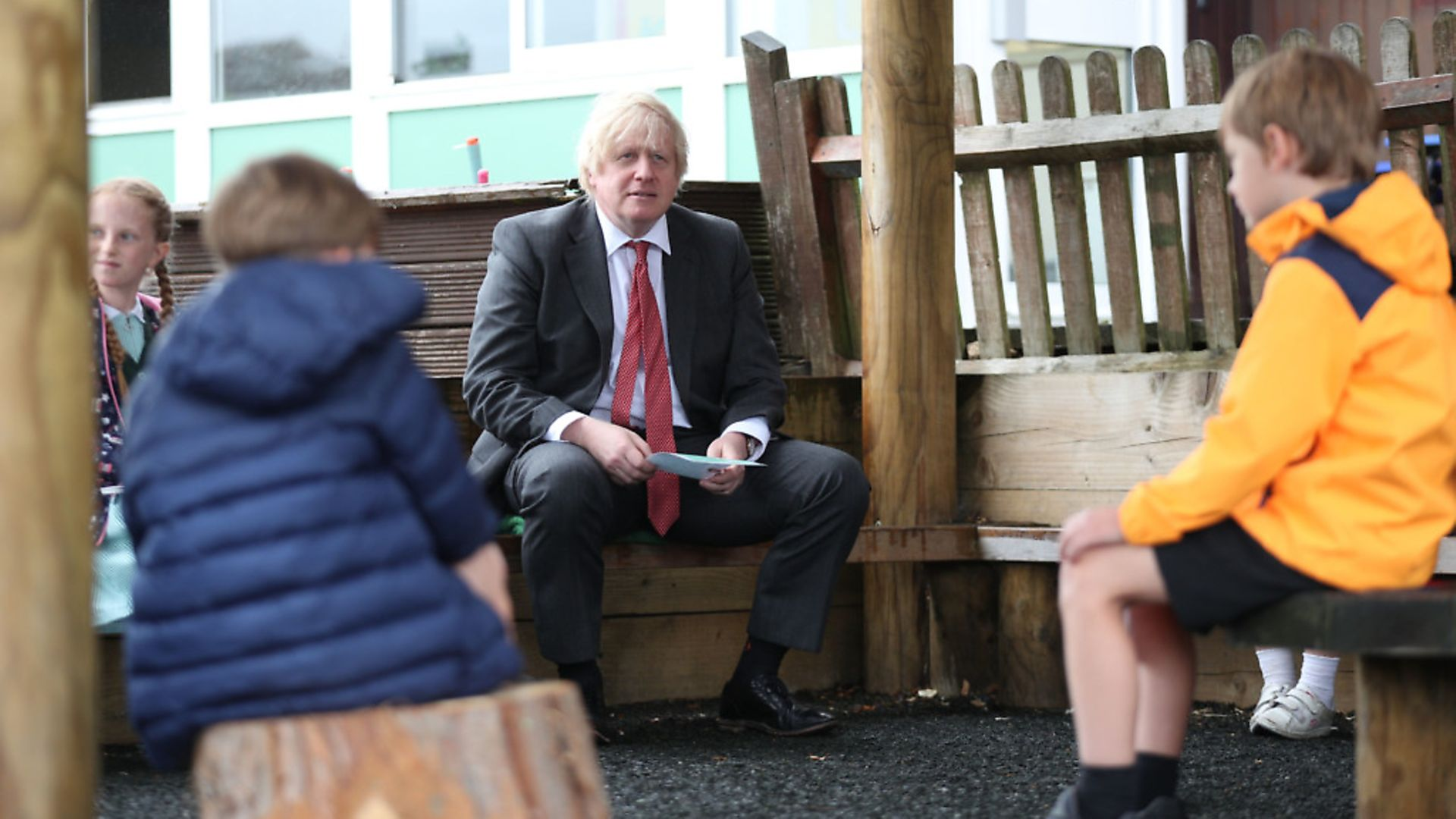 Prime Minister Boris Johnson joins a socially distanced lesson during a visit to Bovingdon Primary School. Photograph: Steve Parsons/PA Wire. - Credit: PA