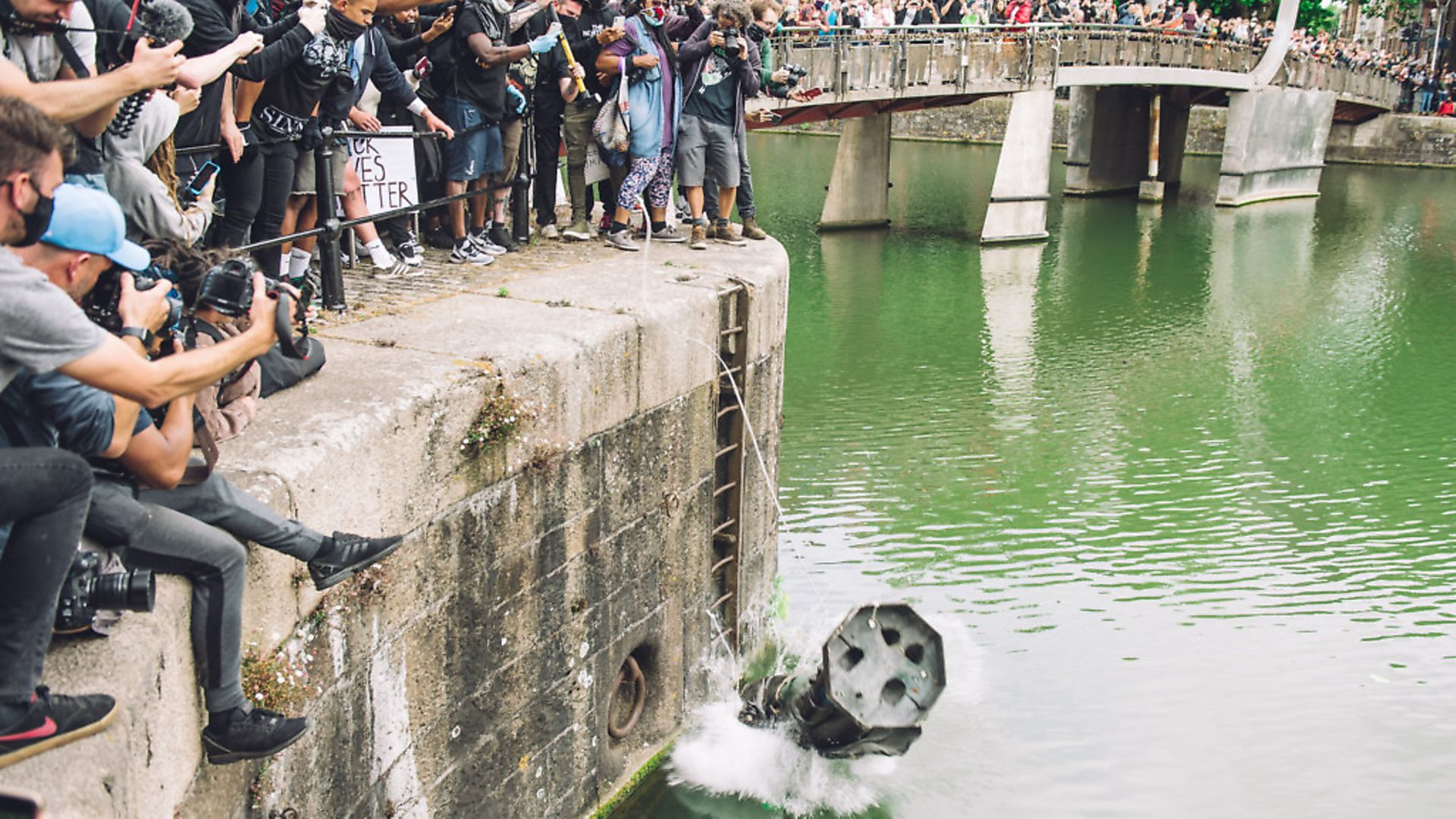 The statue of Colston is pushed into the river Avon. Edward Colston was a slave trader of the late 17th century who played a major role in the development of the city of Bristol, England, on June 7, 2020. (Photo by Giulia Spadafora/NurPhoto via Getty Images) - Credit: NurPhoto via Getty Images