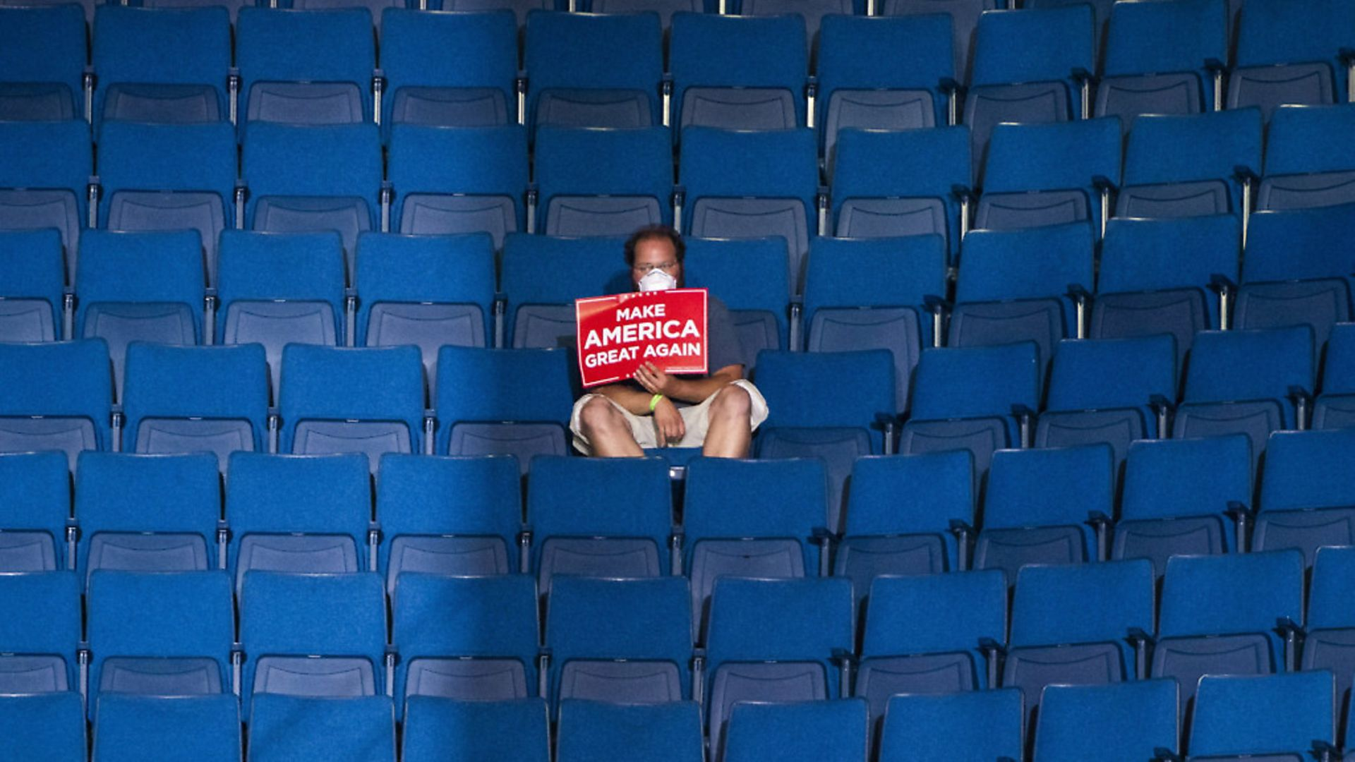 """TULSA, OK - JUNE 20: A supporter sits alone in the top sections of seating as Vice President Mike Pence speaks before President Donald J. Trump arrives for a """"Make America Great Again!"""" rally at the BOK Center on Saturday, June 20, 2020 in Tulsa, OK. (Photo by Jabin Botsford/The Washington Post via Getty Images) - Credit: The Washington Post via Getty Im"""