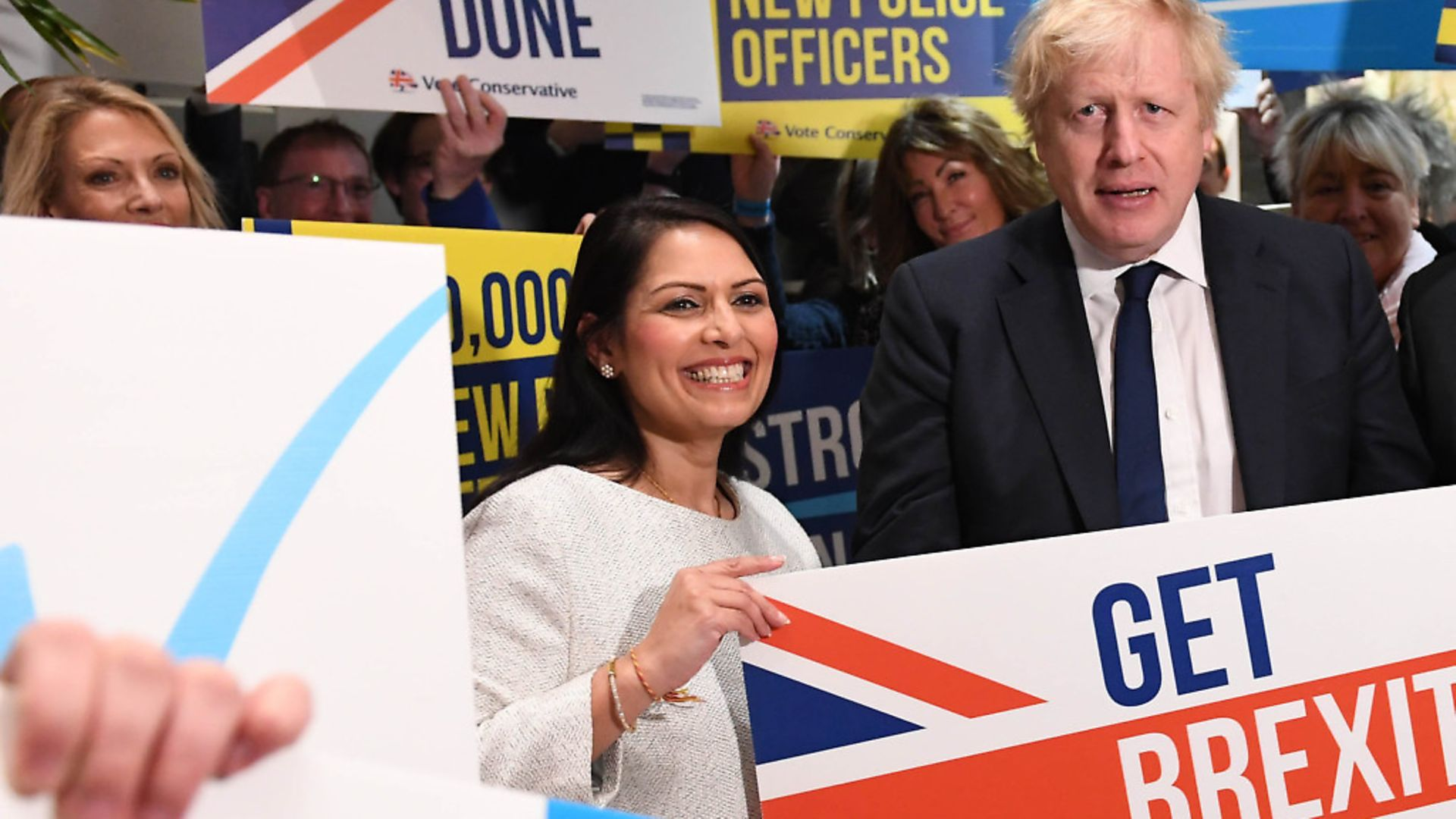 Prime Minister Boris Johnson and Home Secretary Priti Patel during a members rally held at property marketing agency, Think BDW, Colchester, while on the General Election campaign trail. Photograph: Stefan Rousseau/PA. - Credit: PA