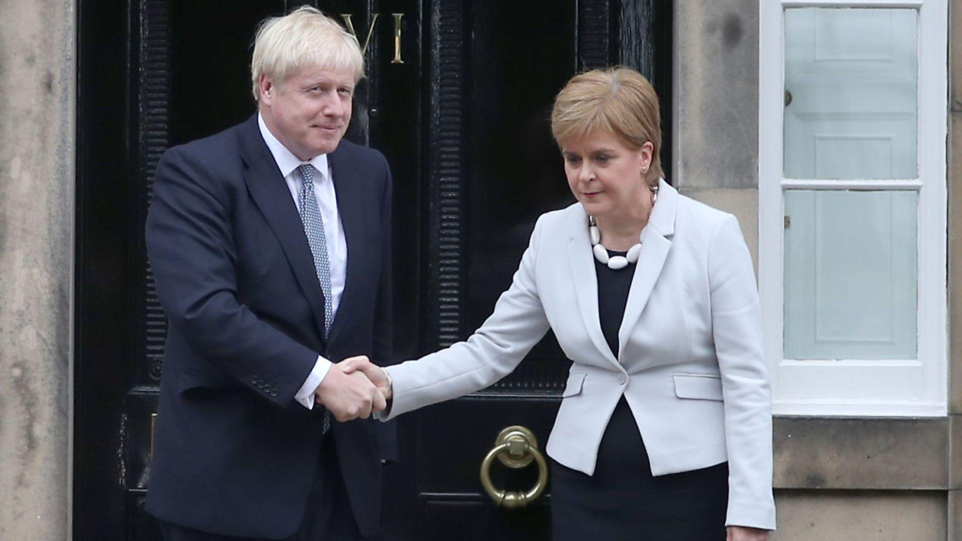 Scotland's first minister Nicola Sturgeon with prime minister prime minister Boris Johnson outside Bute House in Edinburgh. Photograph: Jane Barlow/PA. - Credit: PA