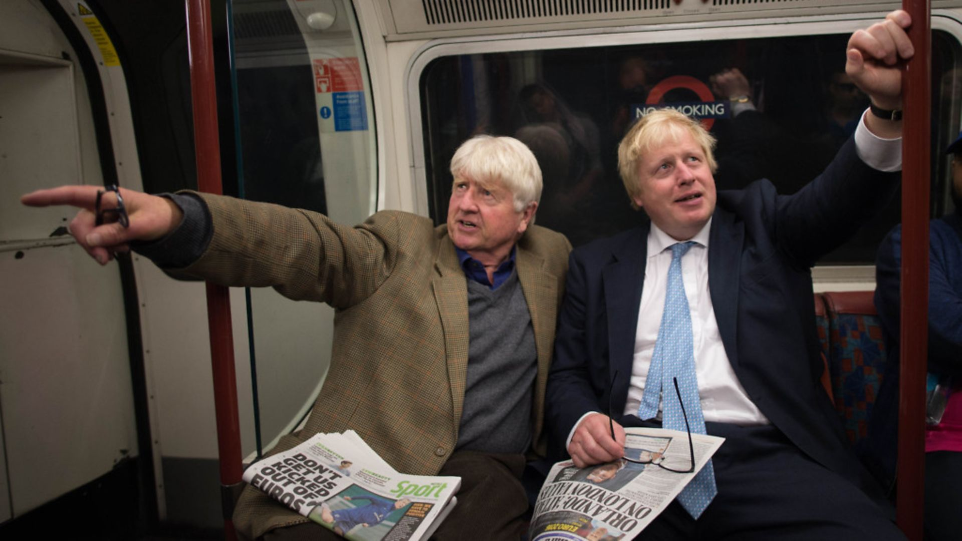 Boris Johnson sits next to his father Stanley (left) on the Bakerloo Line while mayor of London - Credit: Stefan Rousseau/PA