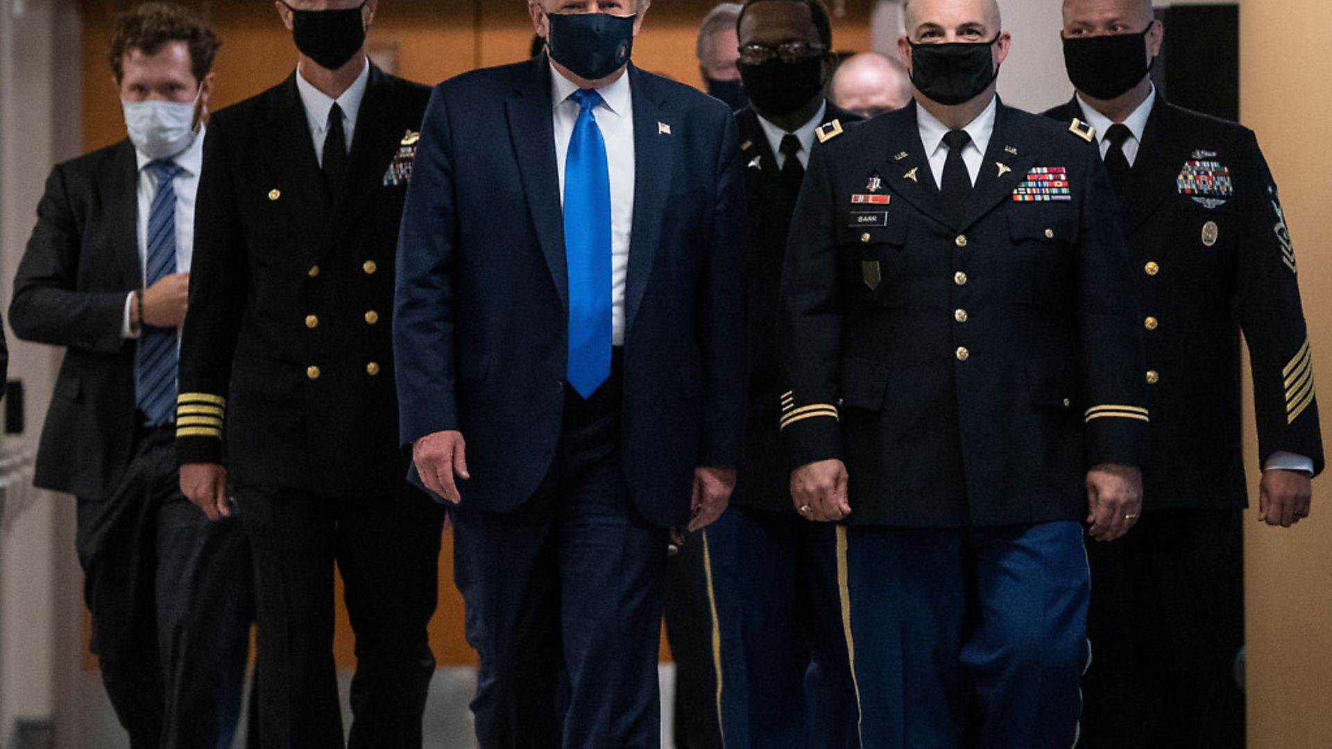 US President Donald Trump wears a mask as he visits Walter Reed National Military Medical Center in  Maryland. Photo: ALEX EDELMAN/AFP via Getty Images - Credit: AFP via Getty Images