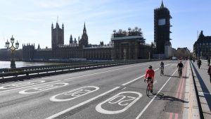 Cyclists riding across an empty Westminster Bridge in London, the day after Prime Minister Boris Johnson put the UK in lockdown to help curb the spread of the coronavirus. Picture: Stefan Rousseau/PA