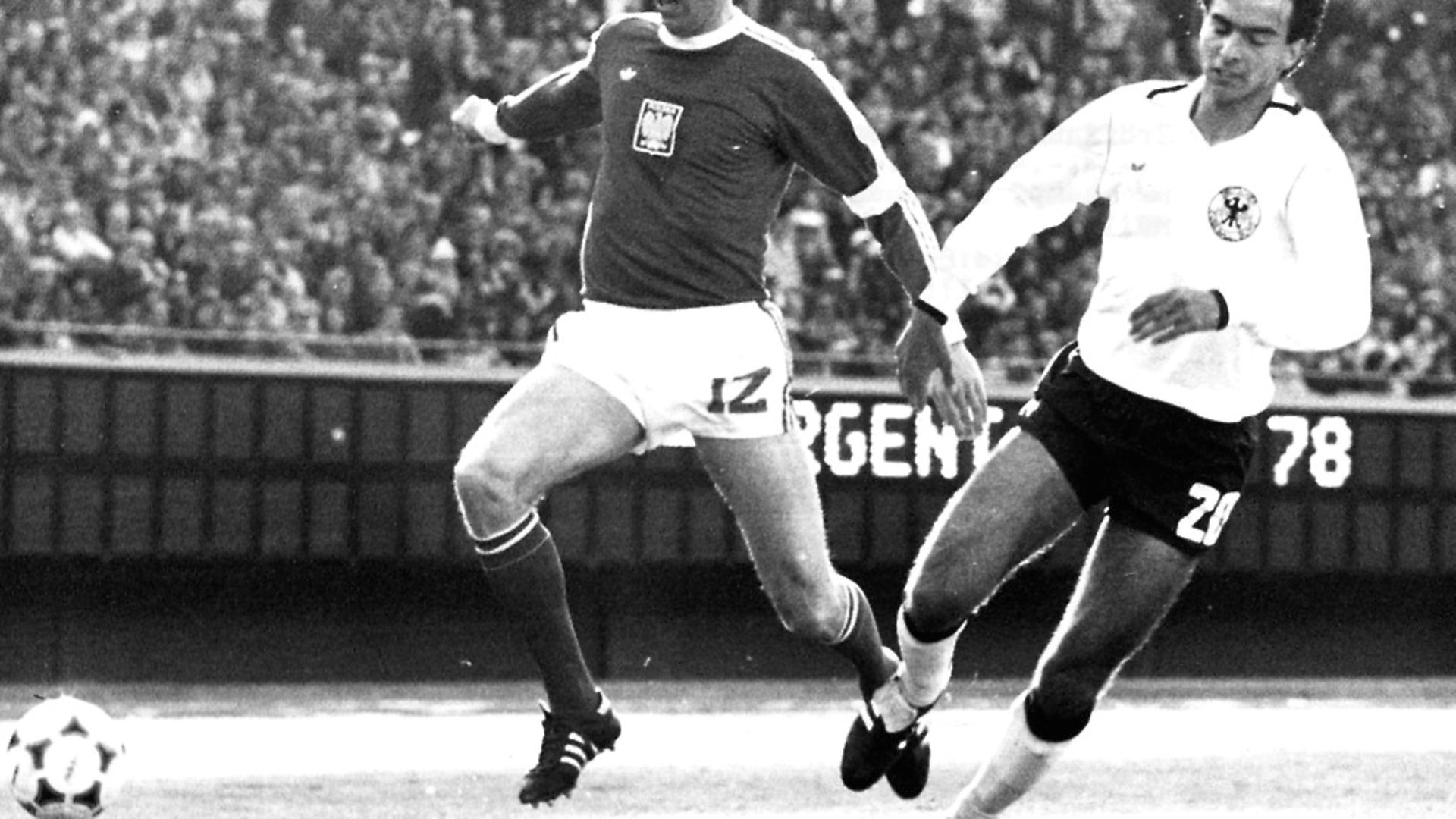 Poland's Kazimierz Deyna, left, skips past Germany's Hansi Mueller in a 0-0 draw at the 1978 FIFA world cup in Argentina. Picture: Getty Images - Credit: ullstein bild via Getty Images