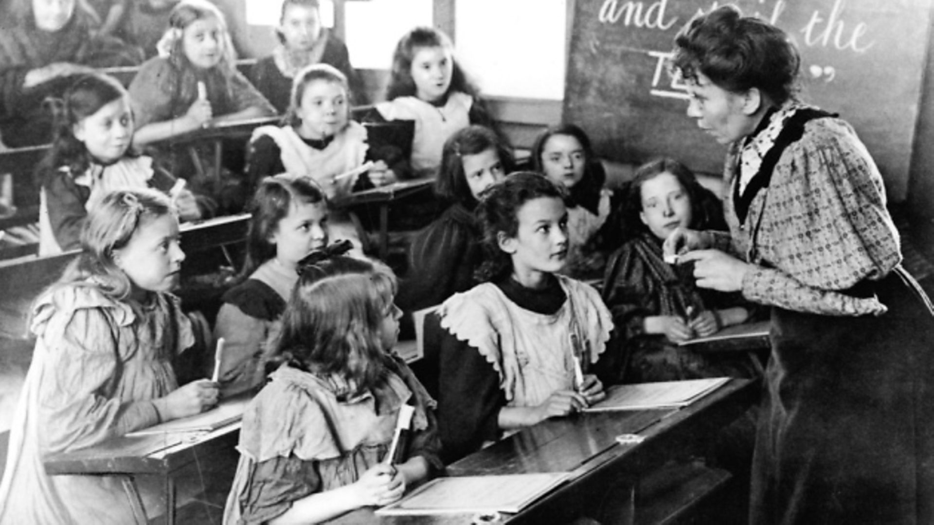 Teacher speaking to classroom of young girls. (Photo by Time Life Pictures/Mansell/The LIFE Picture Collection via Getty Images) - Credit: Time Life Pictures/Mansell/The LIFE Picture Collection via Getty Images
