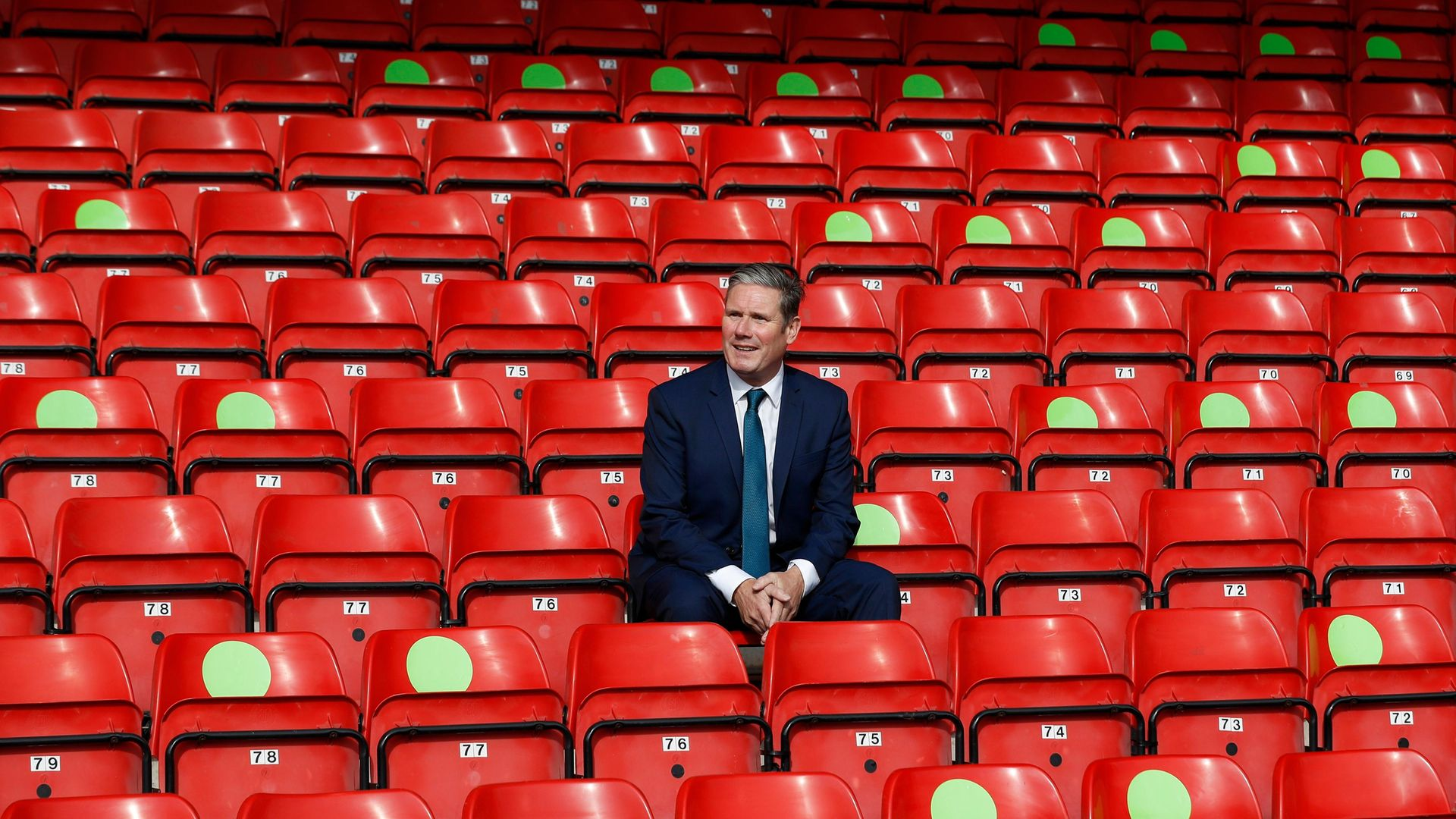 Labour Leader Keir Starmer sits in social distanced seating during a visit of Walsall Football Club - Credit: Getty Images