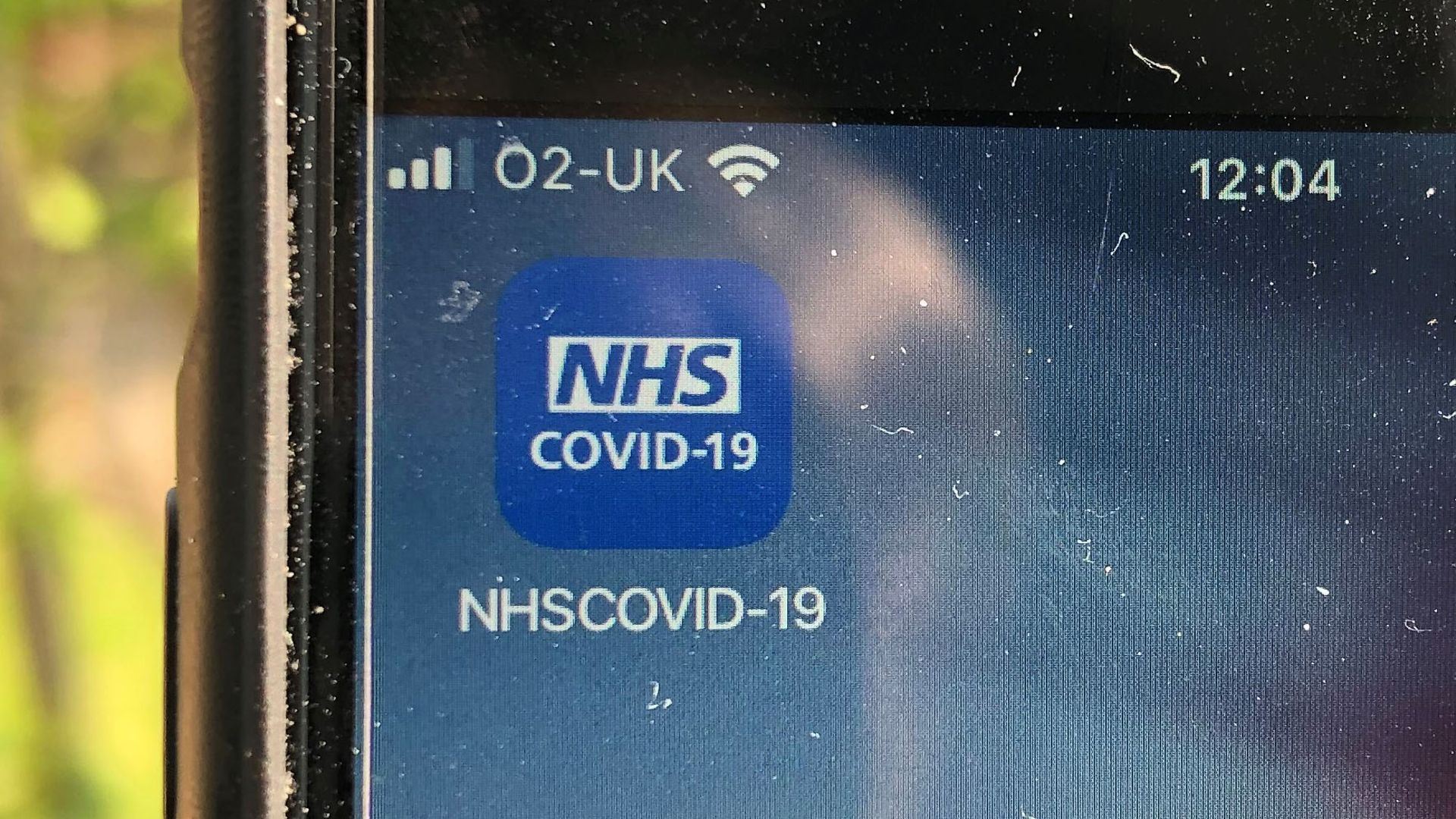 The NHS Covid-19 app on a mobile phone - Credit: PA
