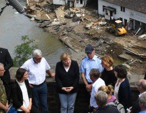 Angela Merkel speaks to locals on a bridge in Schuld, in Rhineland- Palatinate.