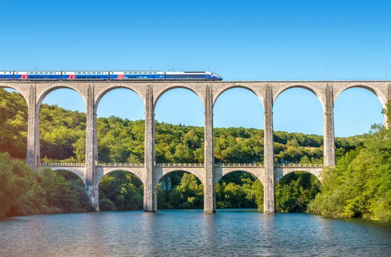 An SNCF train crosses theCize-Bolozon viaduct bridge in Ain, Rhone-Alpes, France