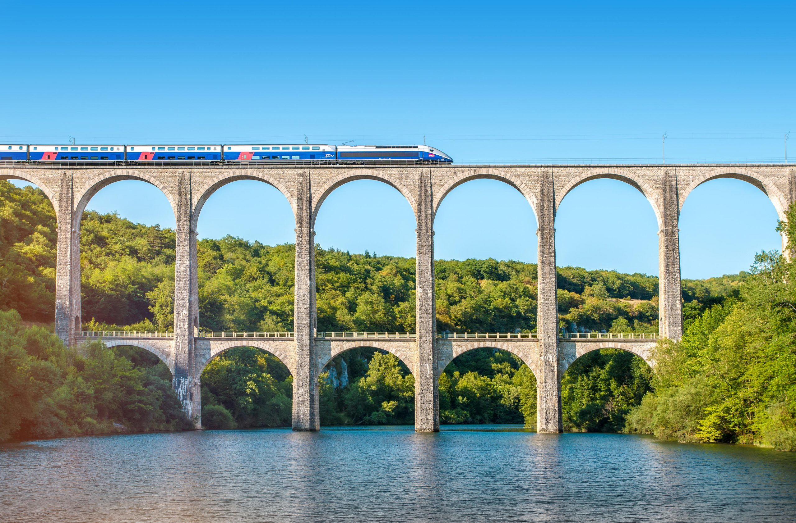 An SNCF train crosses theCize-Bolozon viaduct bridge in Ain, Rhone-Alpes, France. The viaduct accommodates both road and rail.An original span, built in the same location in 1875, was destroyed in the SecondWorld War. It was reconstructed as an urgent post-war project as it was on themain line to Paris.