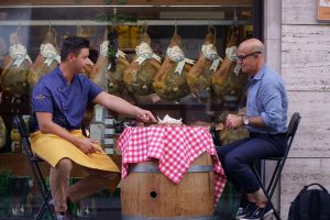 Stanley Tucci (right) with Nicola Salvadori, a prosciutto de Parma expert, in Parma on Searching For Italy