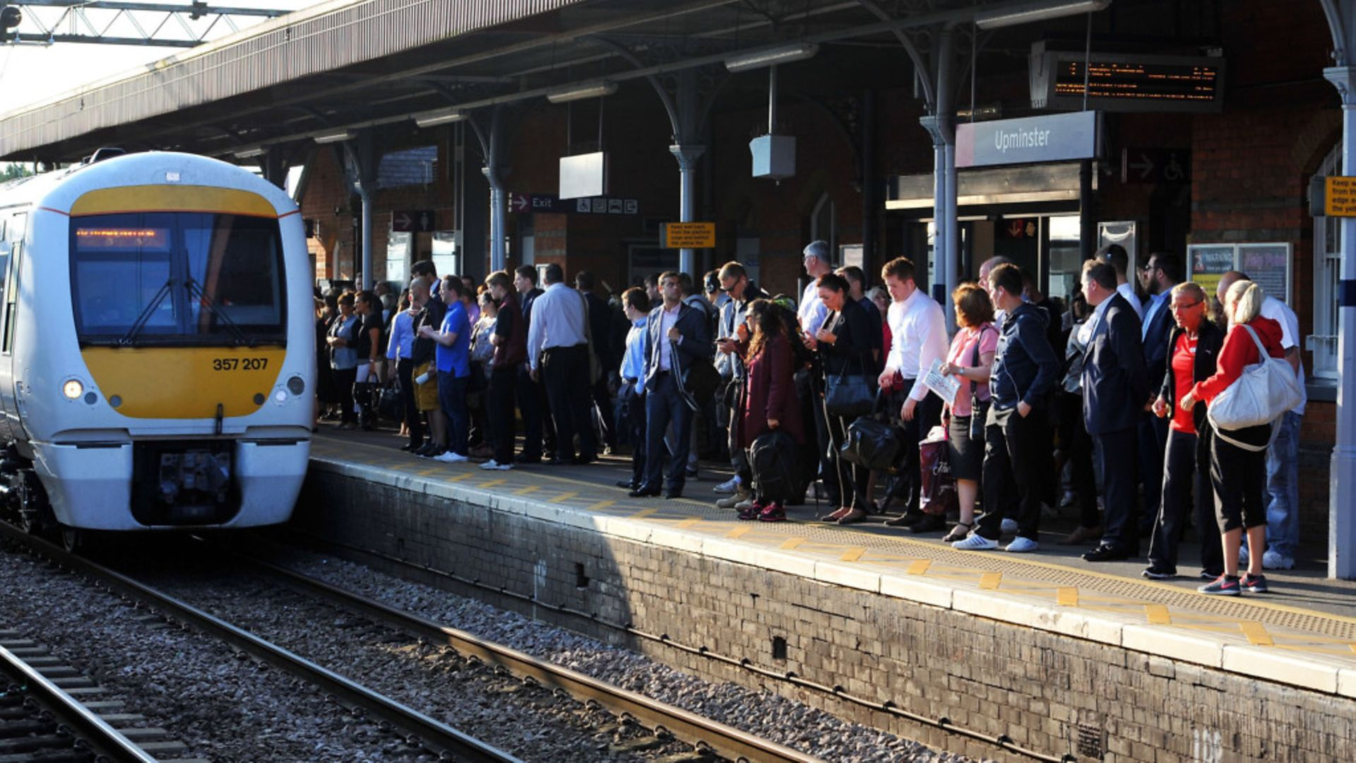 Commuters waiting for a train on the c2c line. - Credit: PA WIRE
