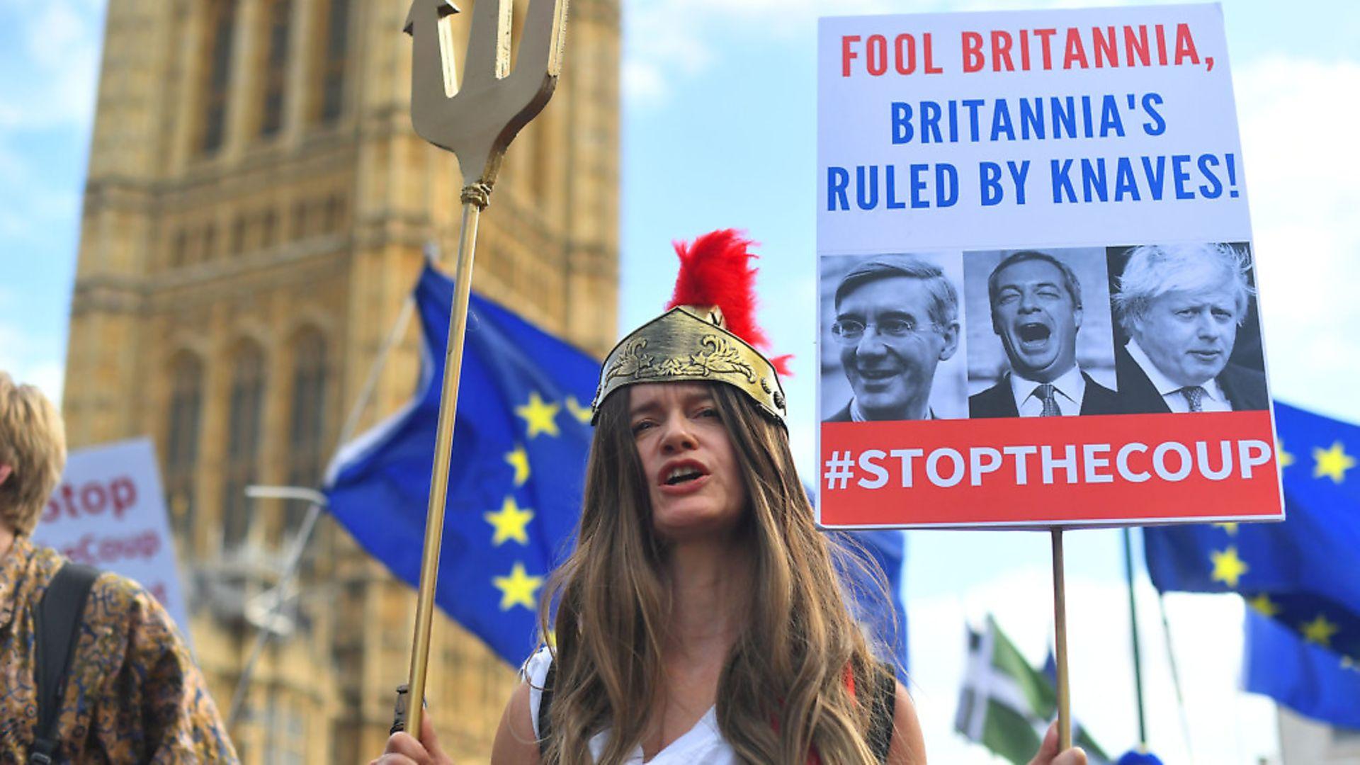 A campaigner protests against Boris Johnson's prorogation of parliament. Photograph: Victoria Jones/PA Wire. - Credit: PA