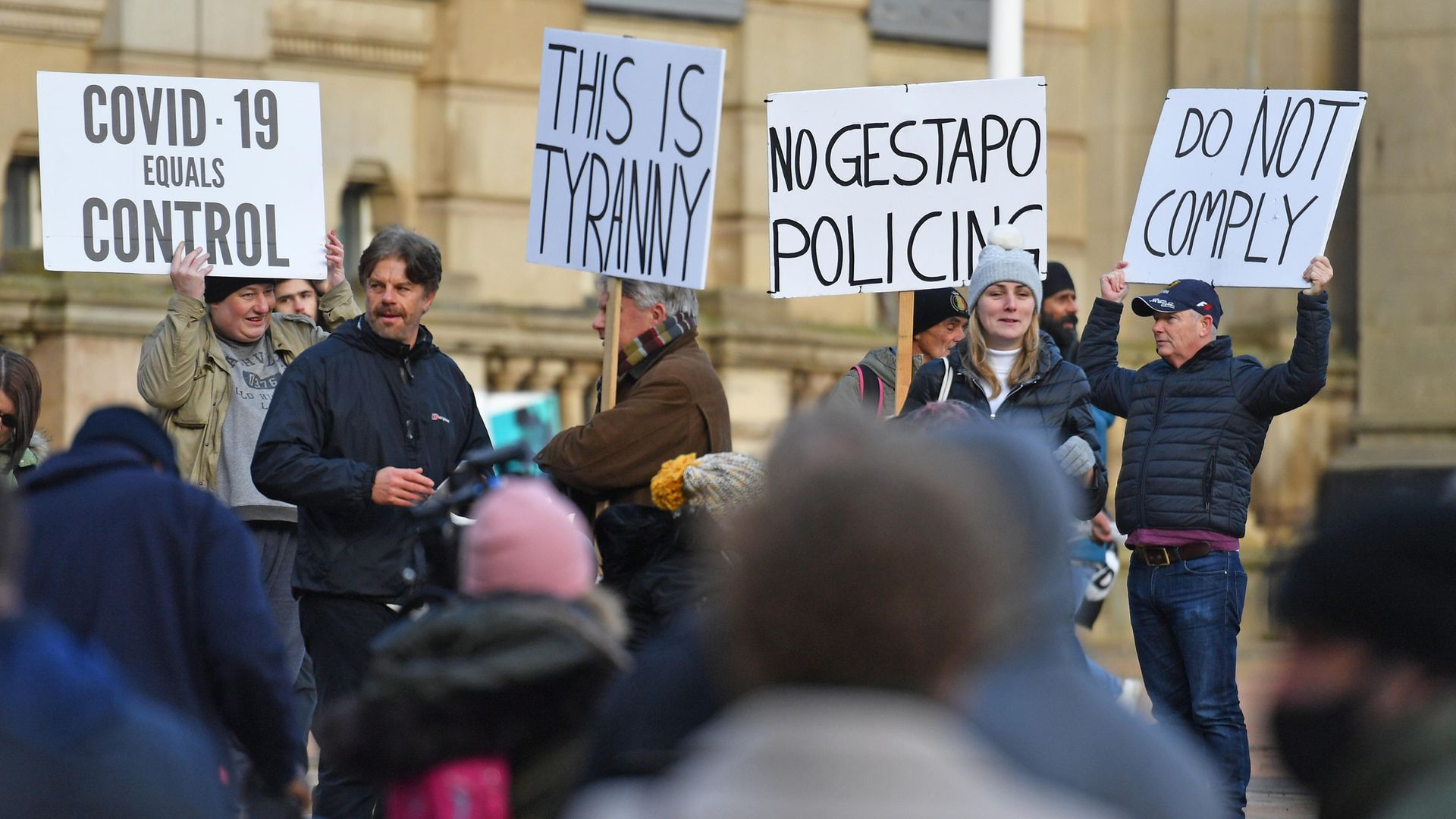 People take part in a demonstration in Victoria Square, Birmingham, to protest against coronavirus lockdown restrictions. - Credit: PA
