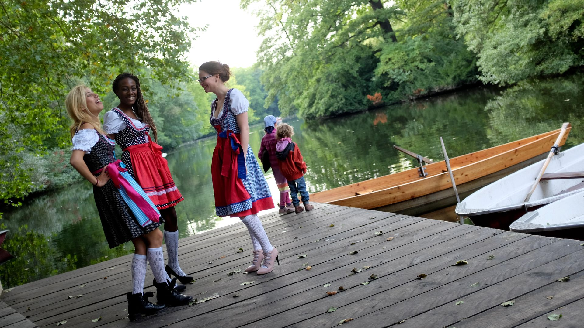 Waitresses wearing the traditional Bavarian dirndl take a break while working Munich's Oktoberfest - Credit: DPA/AFP via Getty Images