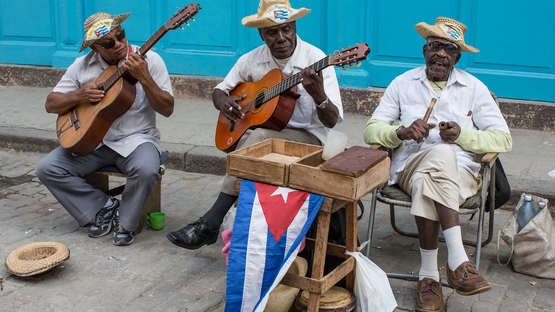 Musicians perform on the street in Old Havana - Credit: Getty Images