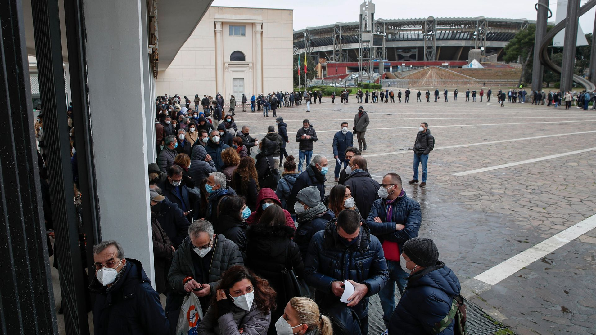 Hundreds of health workers line up to be vaccinated at a facility set up in an exhibition centre in Naples near the city's football stadium - Credit: KONTROLAB/LightRocket via Getty