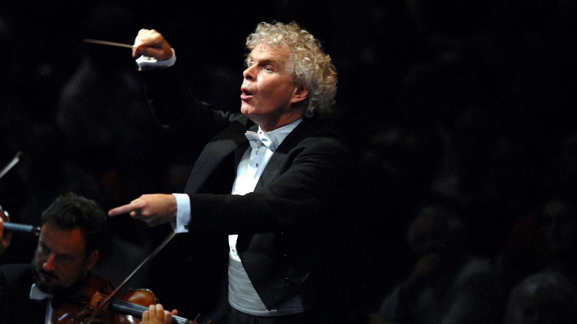 Conductor Sir Simon Rattle (question seven) - Credit: Archant