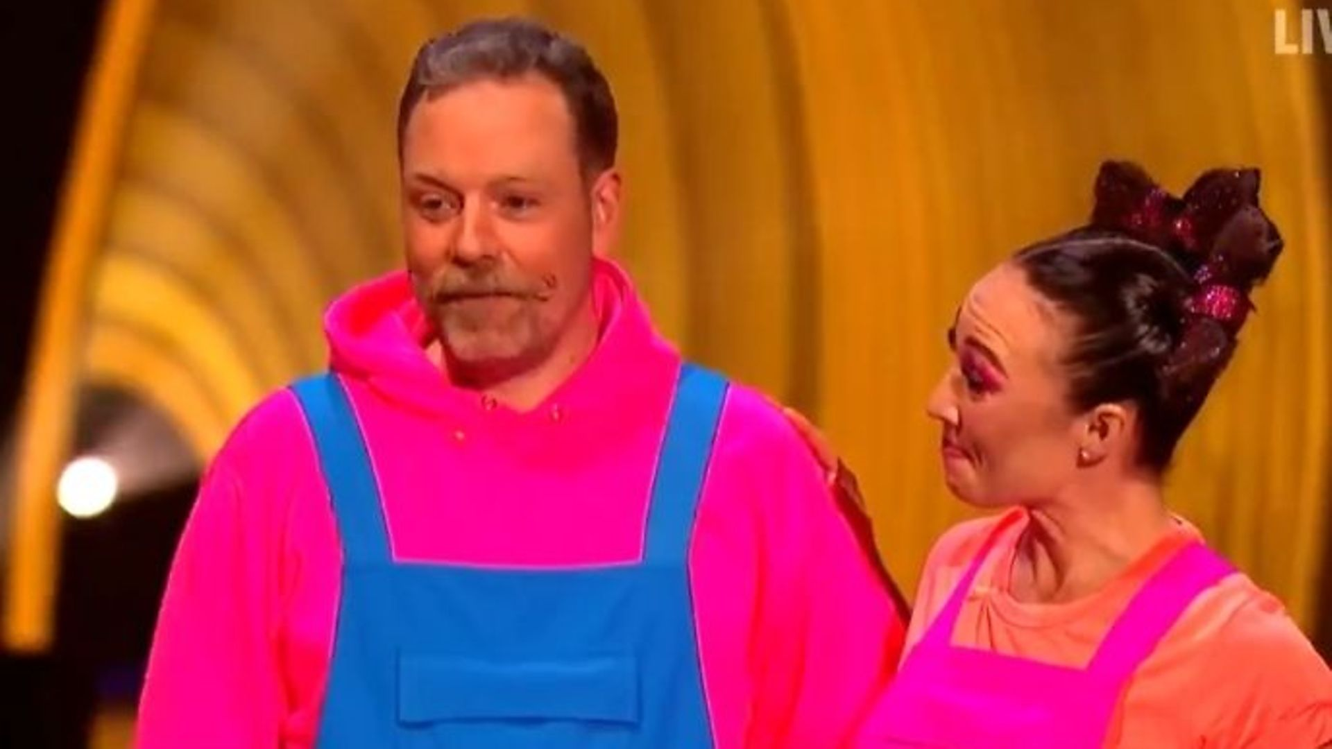 Comedian Rufus Hounds with dance partner Robin Johnstone on ITV's Dancing on Ice - Credit: Twitter