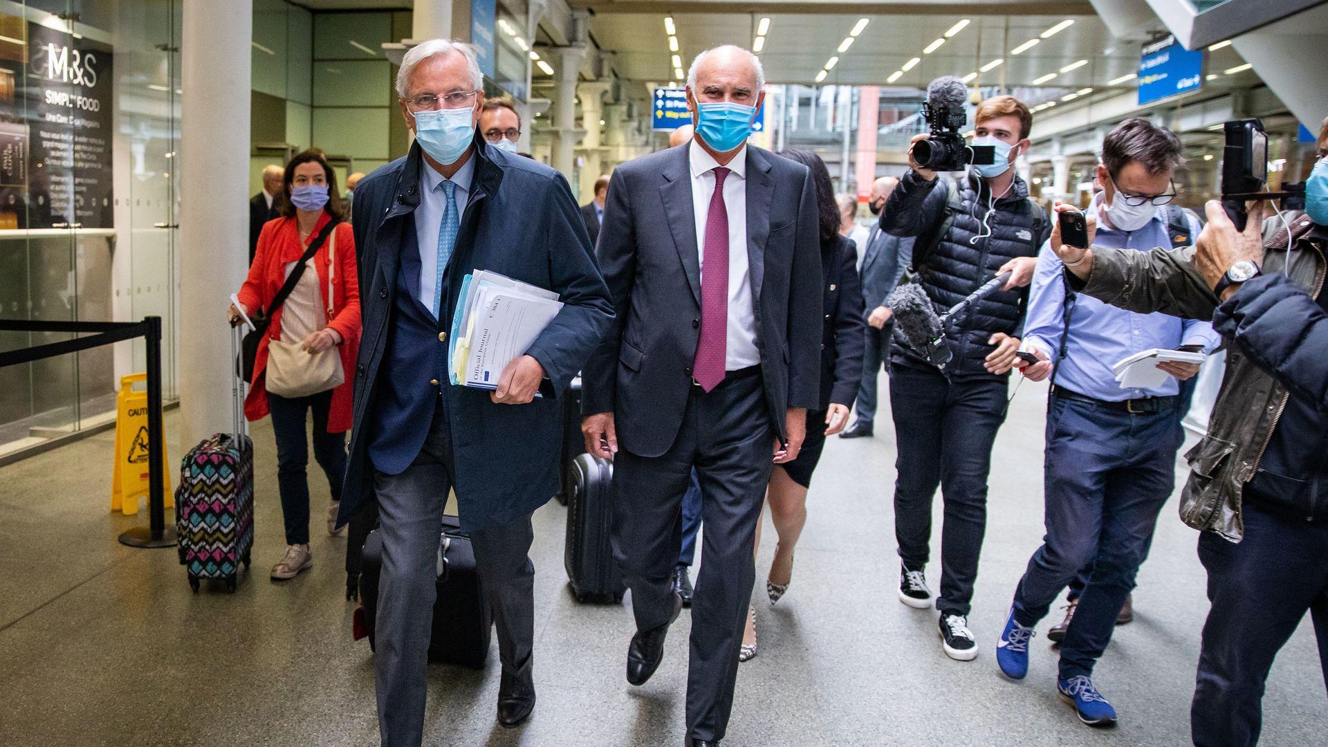 Ex-EU chief Brexit negotiator Michel Barnier (left) arriving from the Eurostar with then EU Ambassador to the UK, Portuguese diplomat Joao Vale de Almeida at St Pancras International railway station, London - Credit: PA