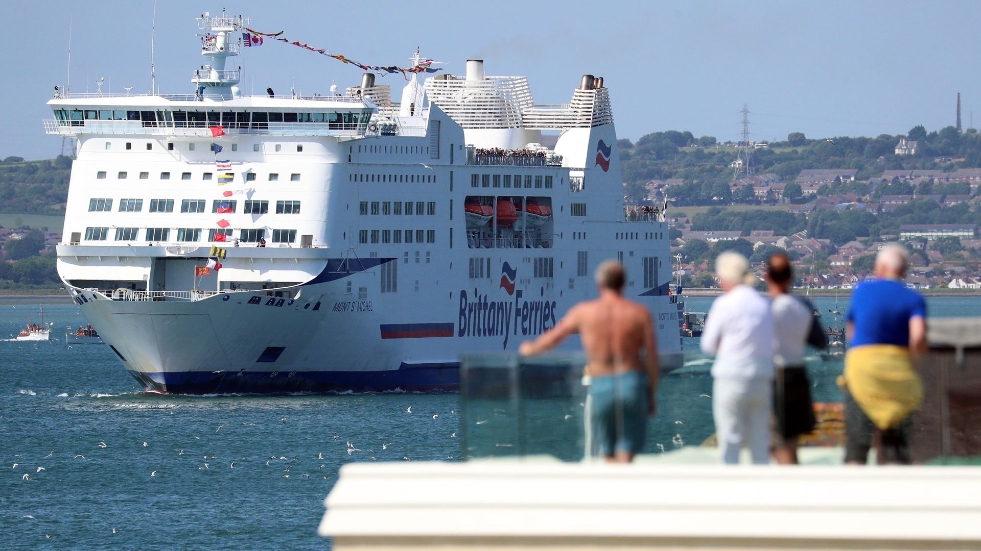 Brittany Ferries' MV Mont Saint Michel leaves Portsmouth harbour escorted by a flotilla of ships from the Royal Navy and Dunkirk small boats association, as it takes D-Day veterans to France, organised by the charity D-Day Revisited. - Credit: PA