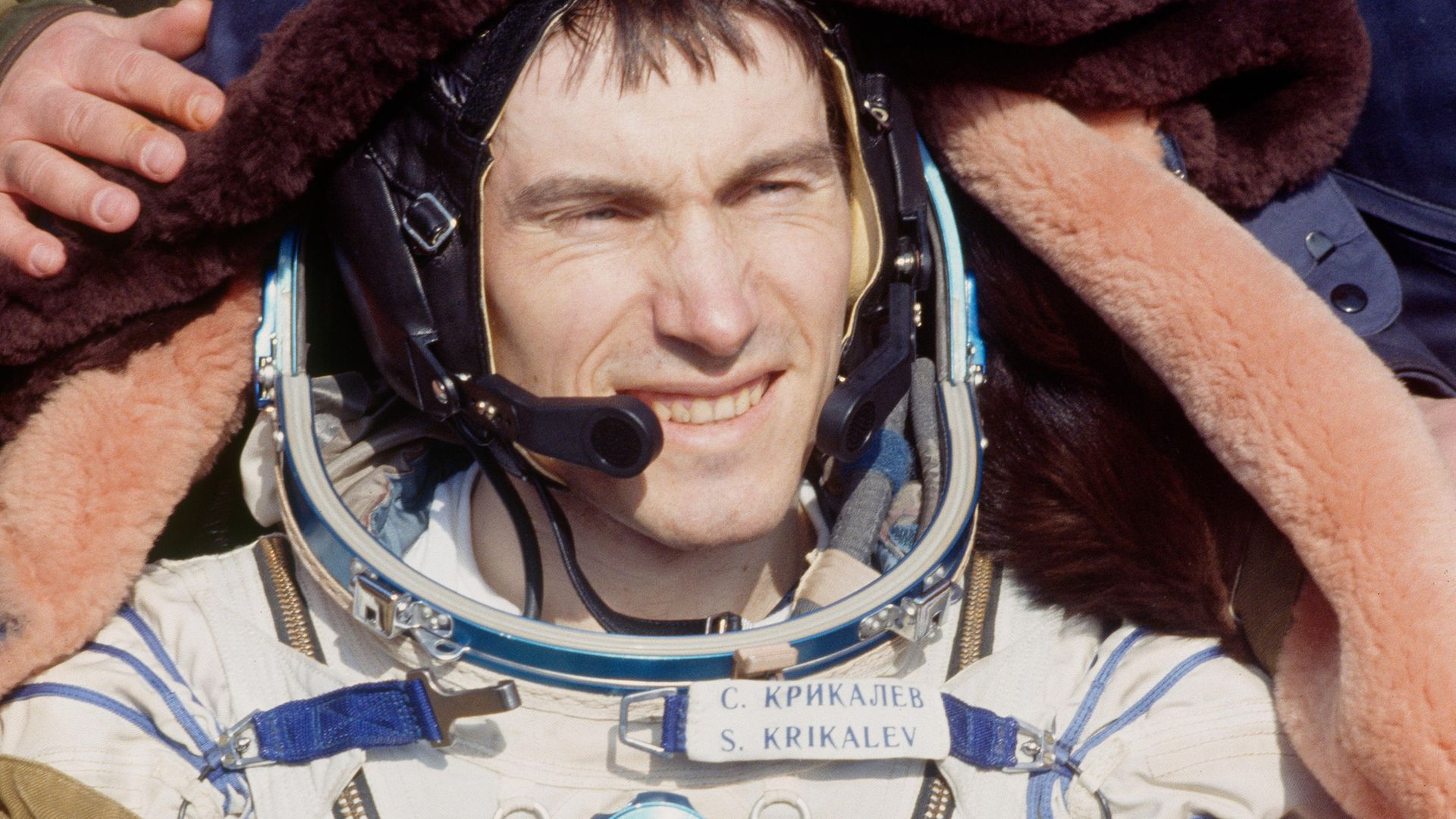 Cosmonaut Sergei Krikalev returns to Earth in his Soviet space suit, months after the demise of the country - Credit: Sygma via Getty Images