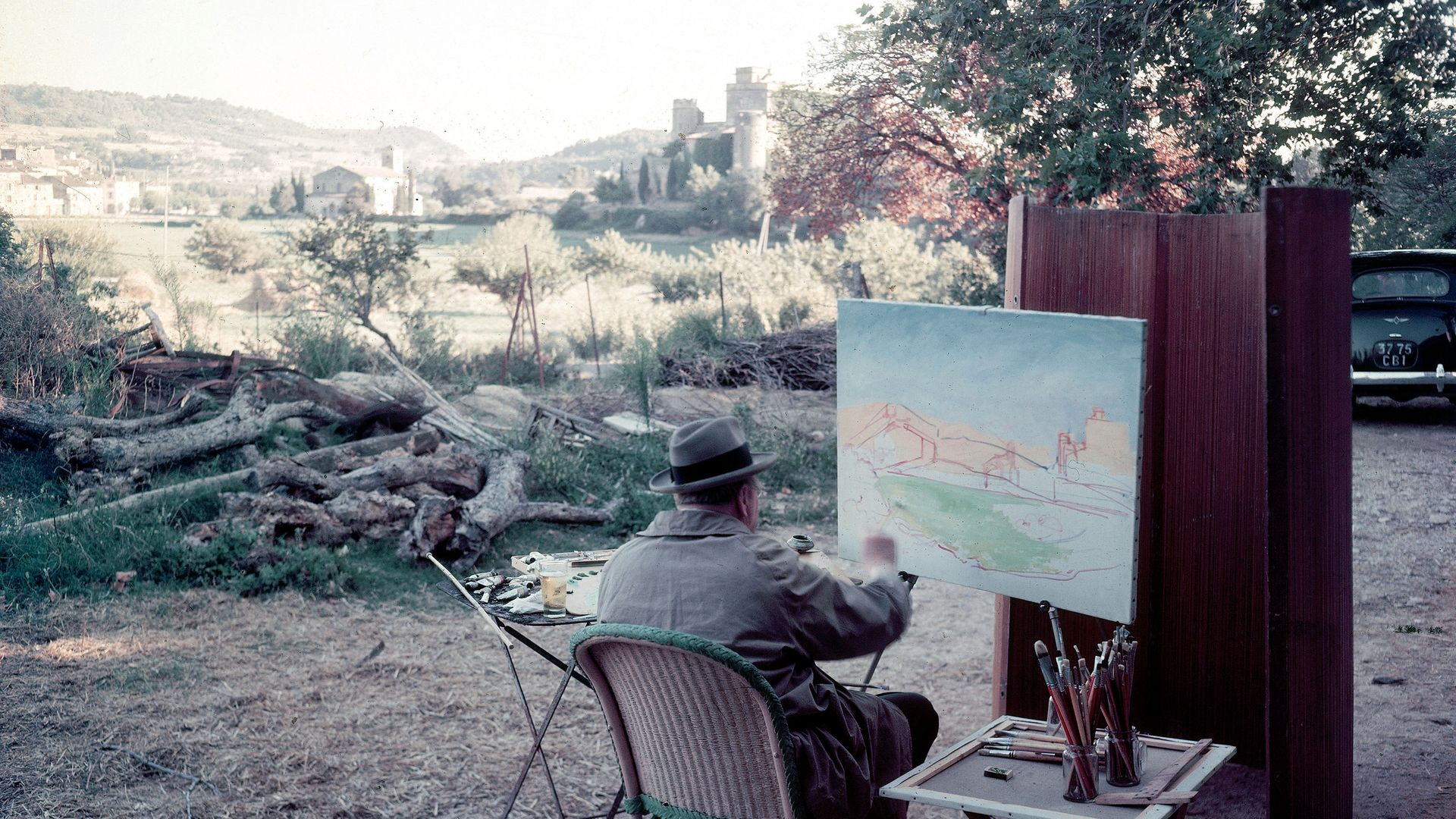 Winston Churchill painting on a visit to the south of France - Credit: The LIFE Picture Collection via