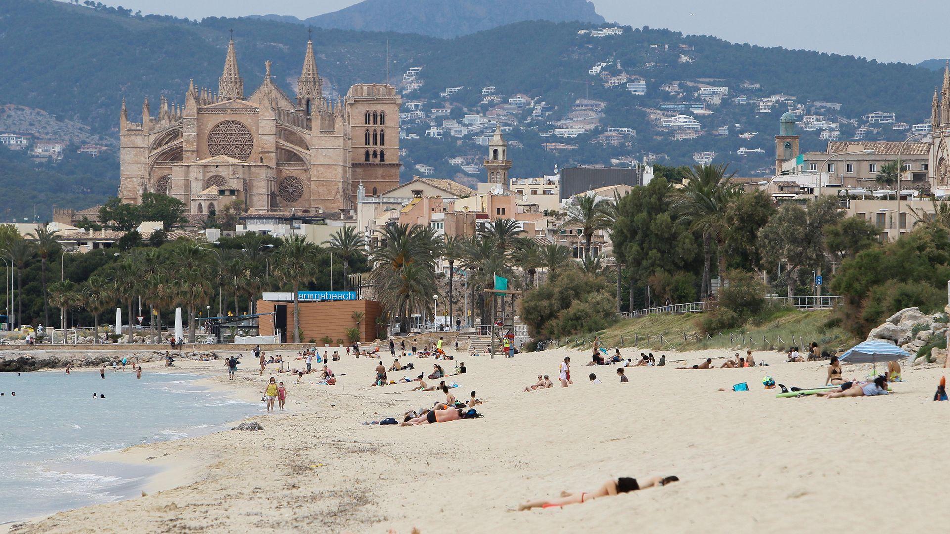 A quiet beach at Palma de Mallorca, in May 2020 - Credit: Europa Press via Getty Images