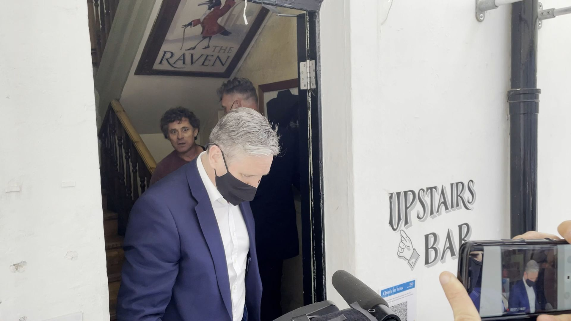 Rod Humphris (back left) landlord of the Raven pub refuses entry to Labour leader Sir Keir Starmer (front) during his visit to Bath - Credit: PA