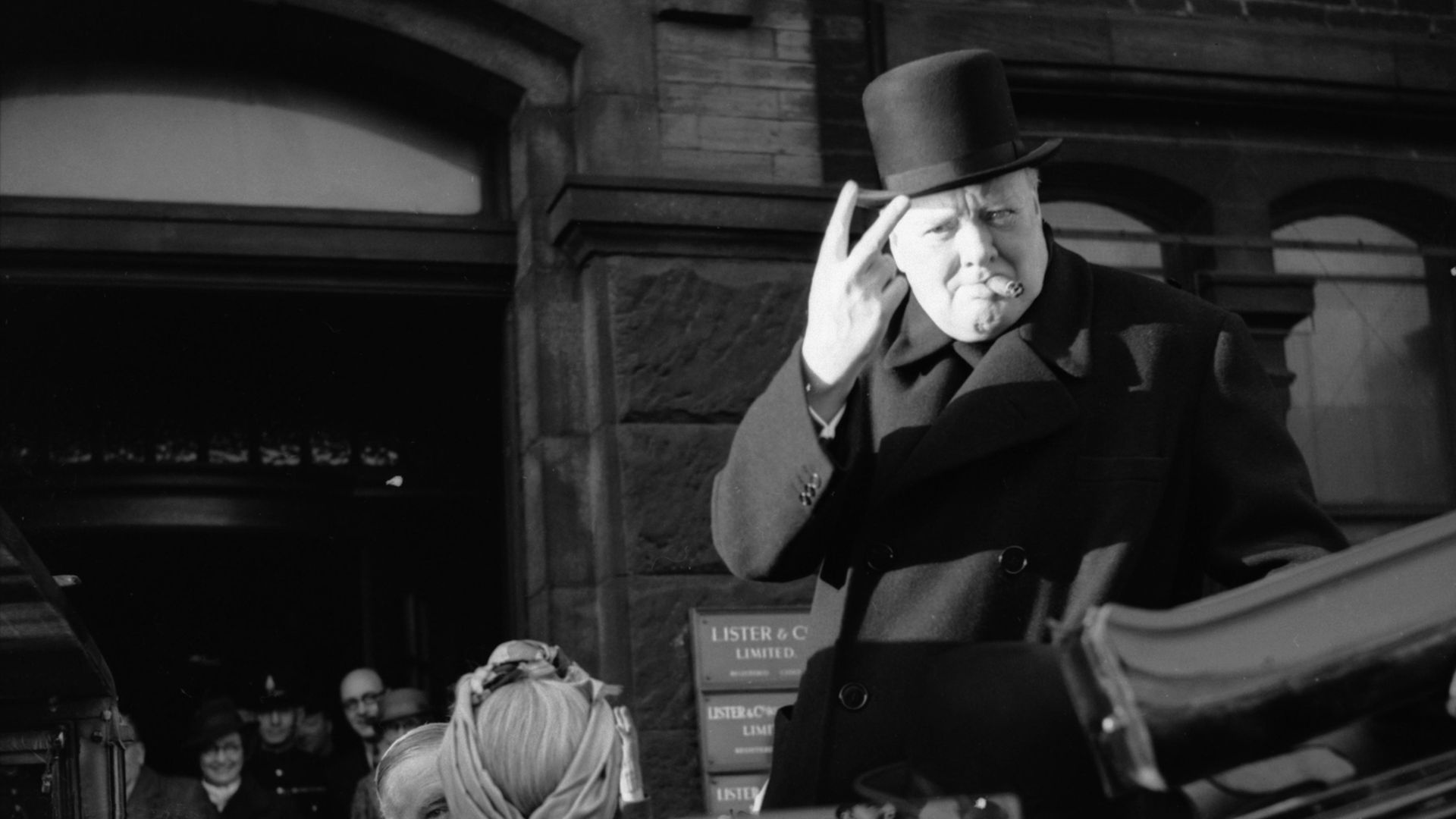 Winston Churchill gives his famous 'V' sign during a visit to Bradford in December 1942 - Credit: Imperial War Museums via Getty I