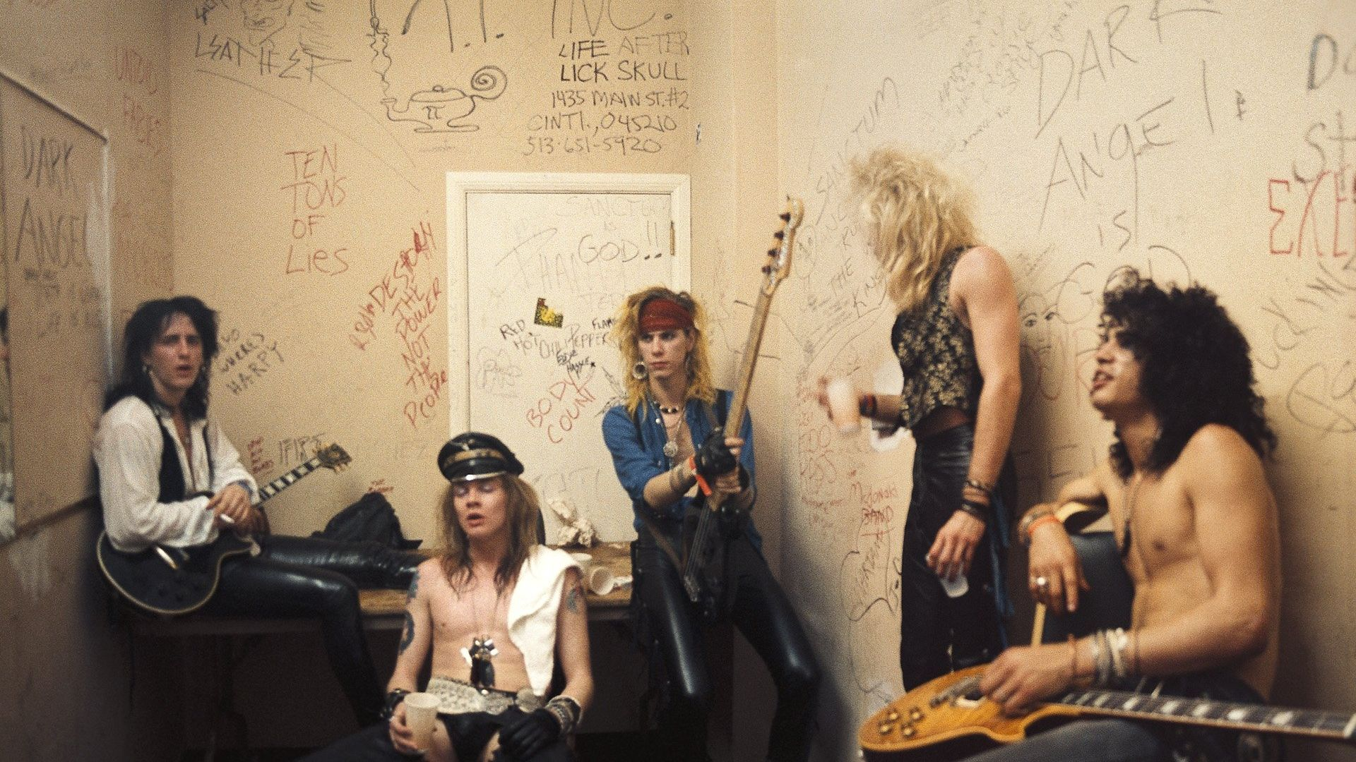 From left to right, Izzy Stradlin, Axl Rose, Duff McKagan, Steven Adler and Slash of Guns n' Roses pose for a portrait backstage at Fenders Ballroom, Long Beach, on March 31, 1986. They were opening up for Johnny Thunders that night and got signed to Geffen five days later - Credit: Getty Images