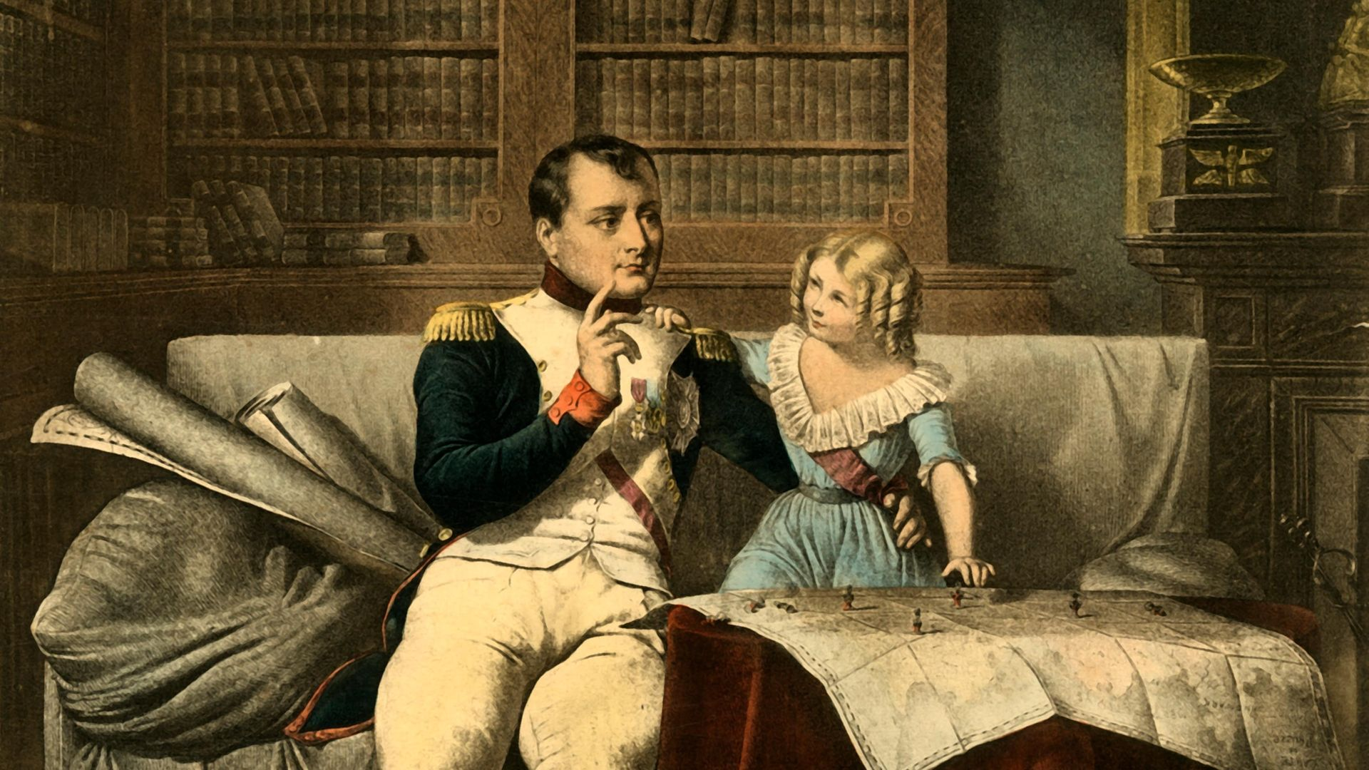 Napoleon, surrounded by books in his office, takes a break from reading to discuss military matter with a small child, in this image from 1921. Despite the dress and ringlets, this may be his son, also named Napoleon - Credit: The Print Collector/Heritage Ima