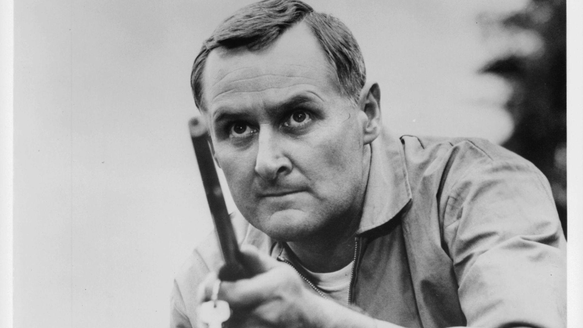 Peter Vaughan aiming gun in a scene from the 1965 film Fanatic, released in the US as Die! Die! My Darling! - Credit: Getty Images