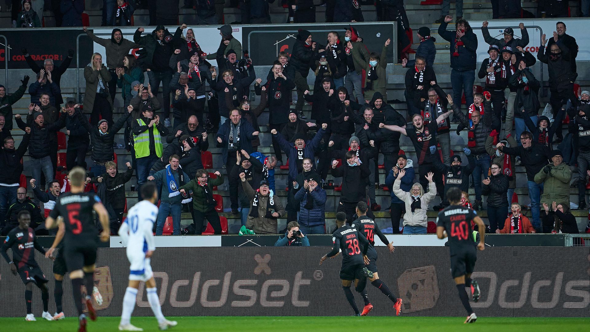 UNFAMILIAR SIGHT: FC Midtjylland fans react as their team goes 1-0 up against  FC Copenhagen last week. Covid passports means supporters can now attend matches - Credit: FrontzoneSport via Getty Images