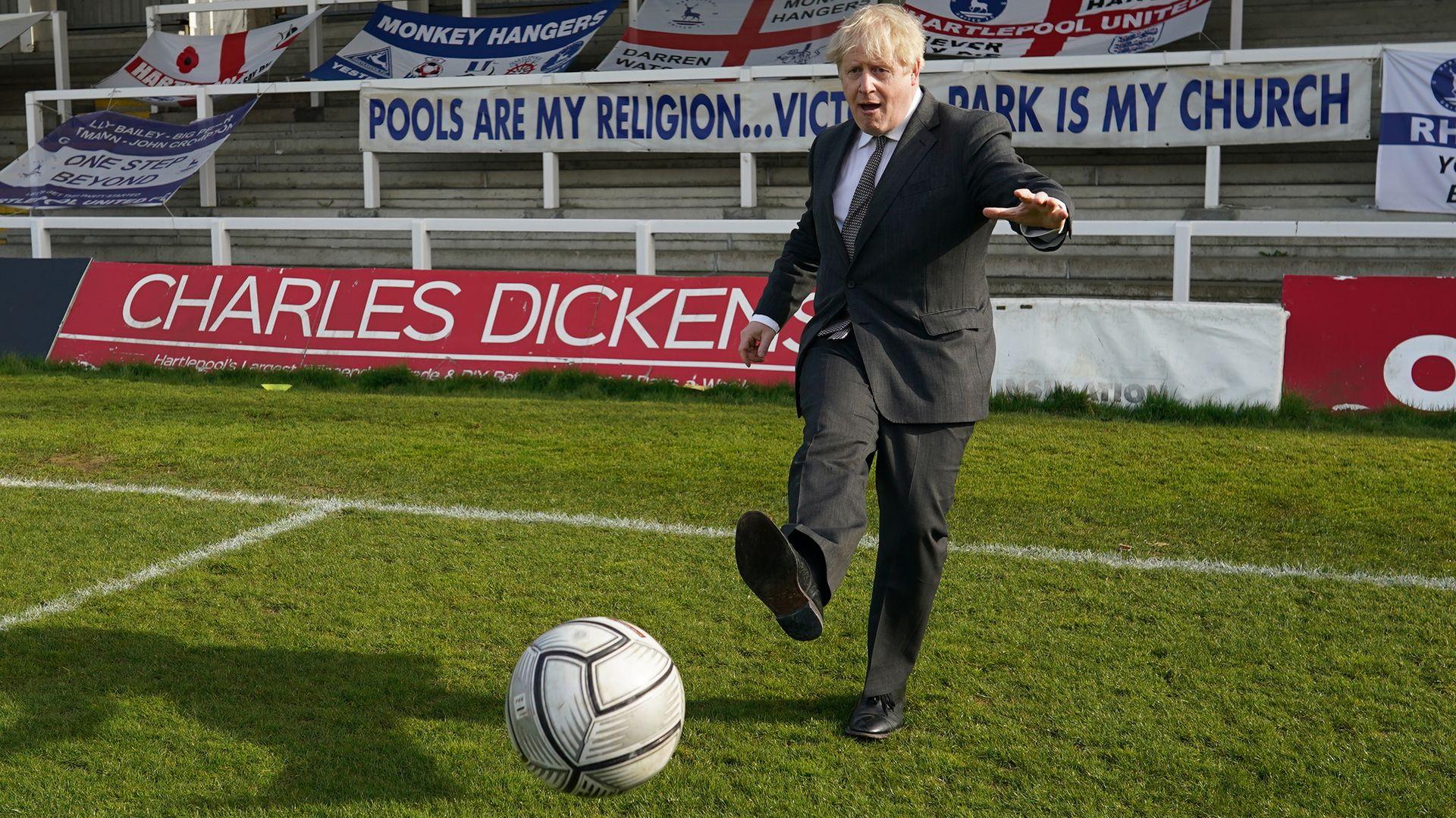 Prime Minister Boris Johnson kicks a football during a visit to the Hartlepool United Football Club - Credit: PA