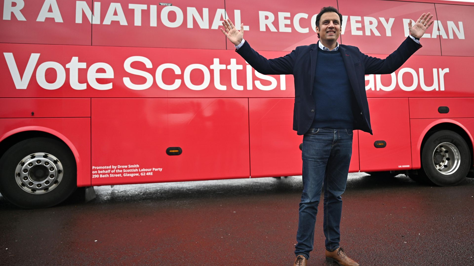 Scottish Labour leader Anas Sarwar poses in front of his party's election bus, in Glasgow - Credit: Getty Images
