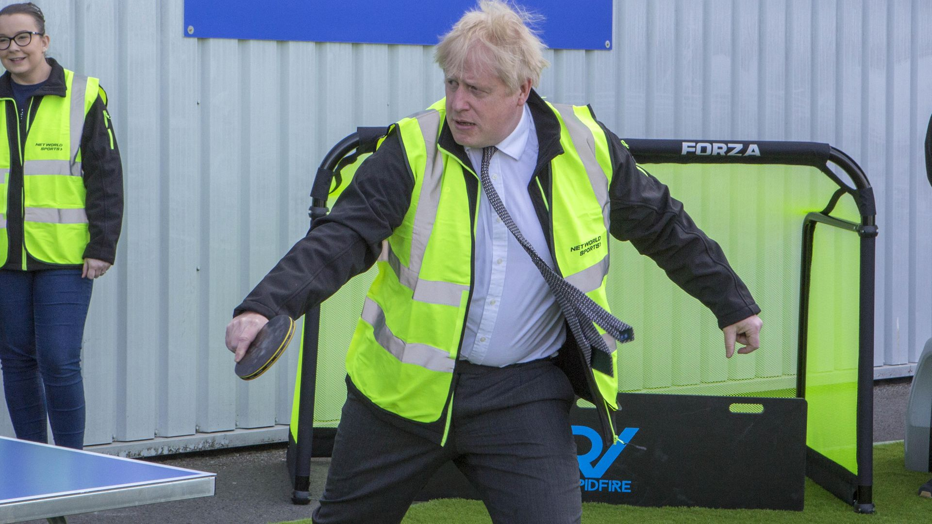 Prime Minister Boris Johnson plays table tennis during a visit to Wrexham - Credit: PA