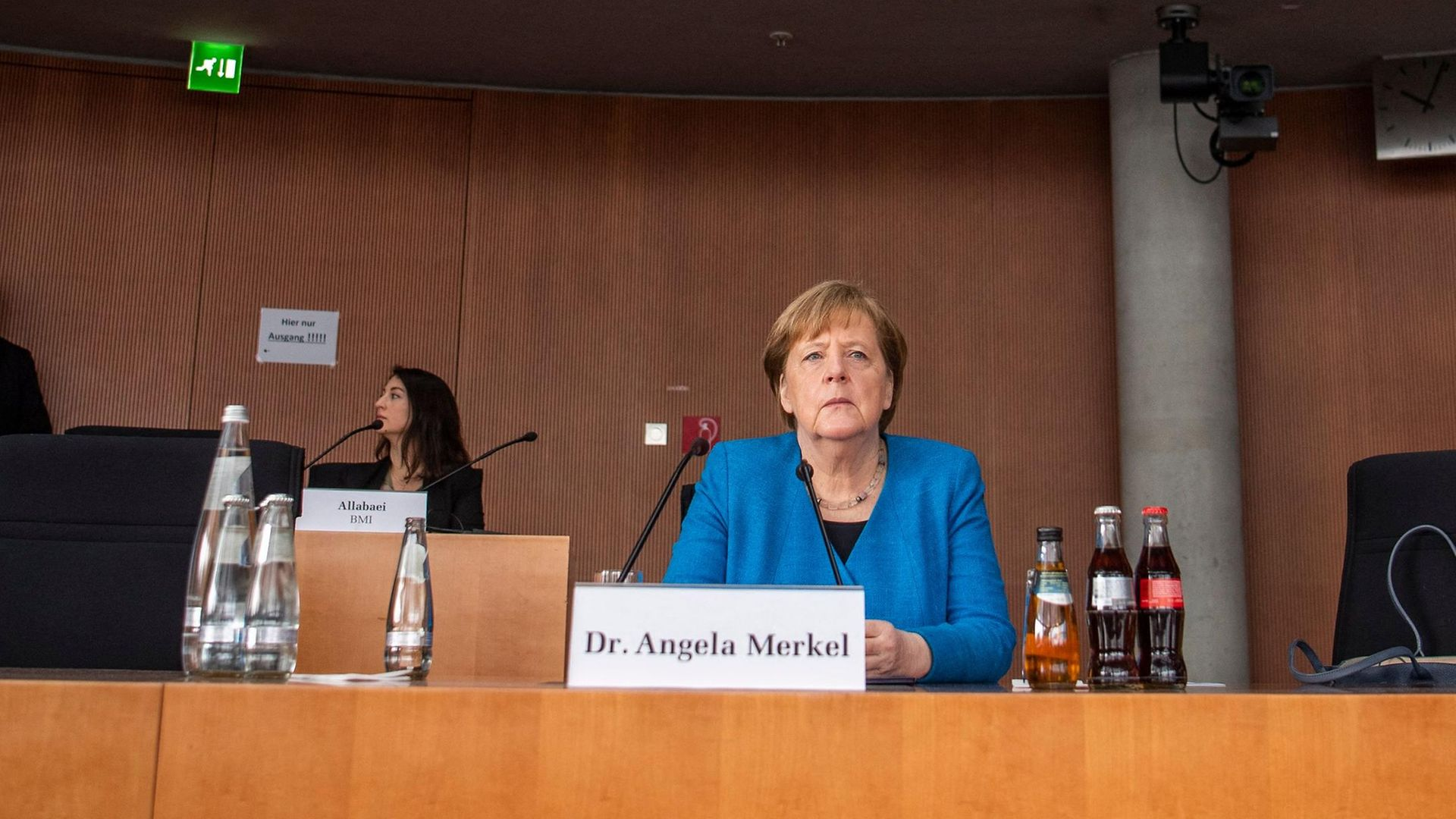 Angela Merkel giving evidence to the parliamentary committee investigating the Wirecard scandal - Credit: AFP via Getty Images