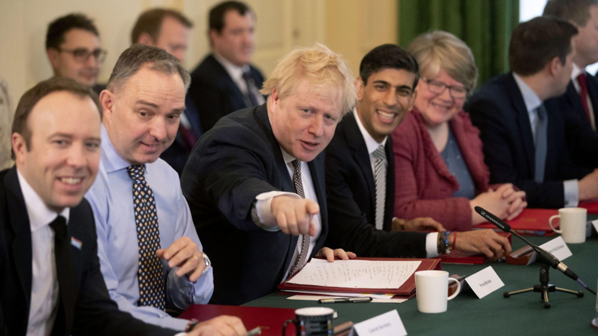 Boris Johnson alongside cabinet members - Credit: Matt Dunham/PA Wire