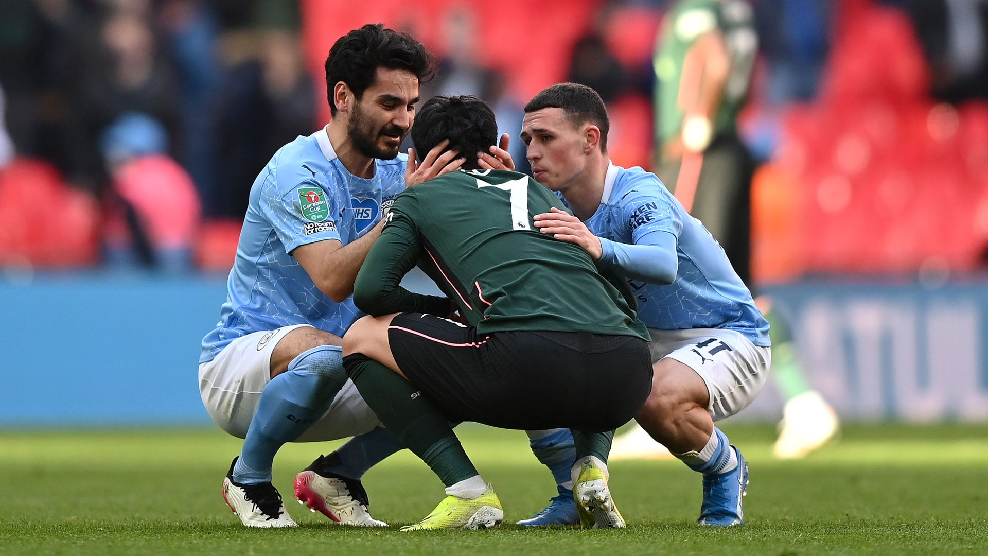 Son Heung-Min of Tottenham Hotspur is consoled by Ilkay Gündogan and Phil Foden of Manchester City after the Carabao Cup final - Credit: Photo by Tottenham Hotspur FC/Tottenham Hotspur FC via Getty Images