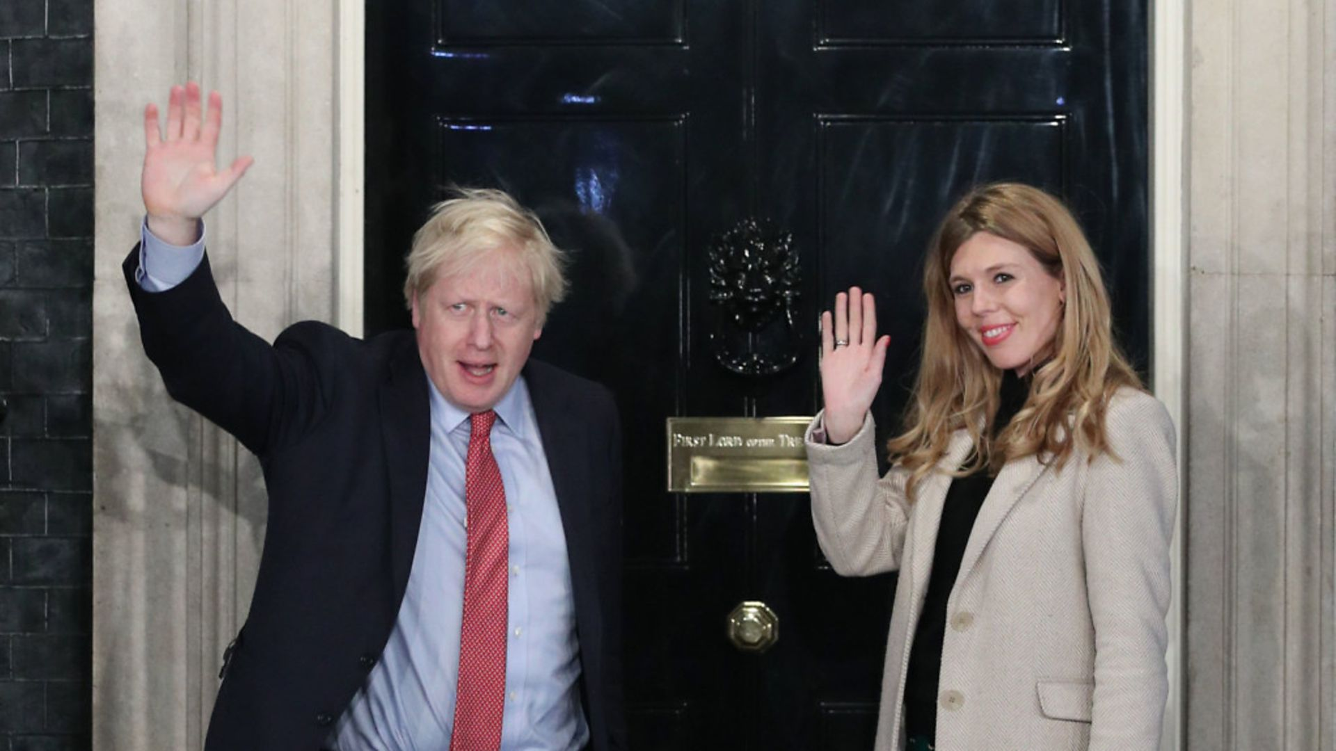 Prime minister Boris Johnson with fiancée Carrie Symonds outside No 10 - Credit: PA