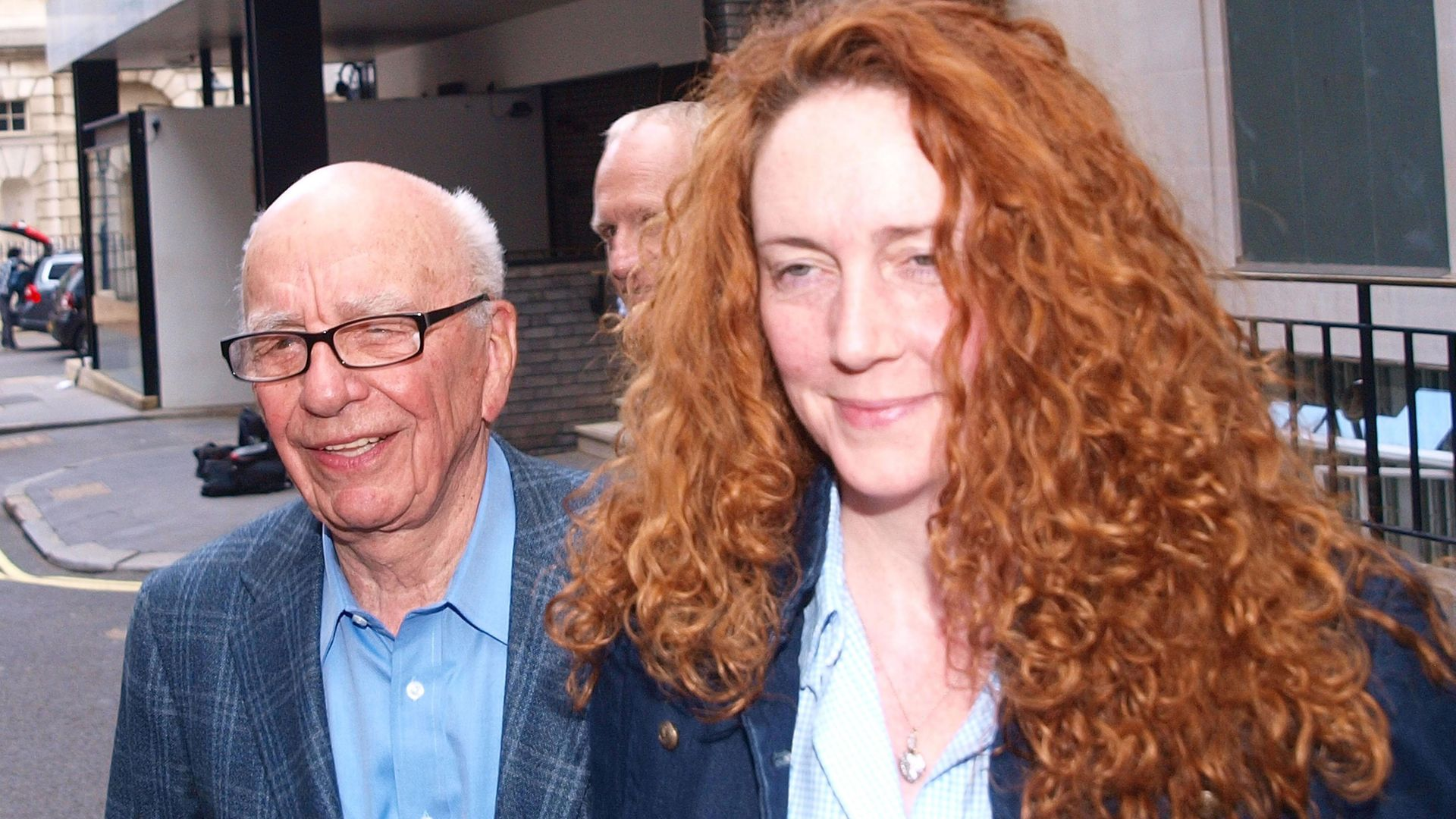 News International chief executive Rebekah Brooks and Rupert Murdoch are seen outside Murdoch's London flat. - Credit: PA