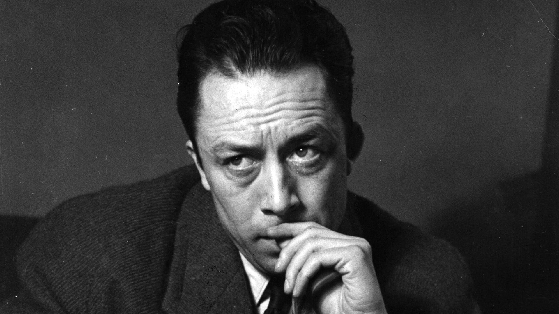Albert Camus, on a visit to London in 1952 - Credit: Getty Images