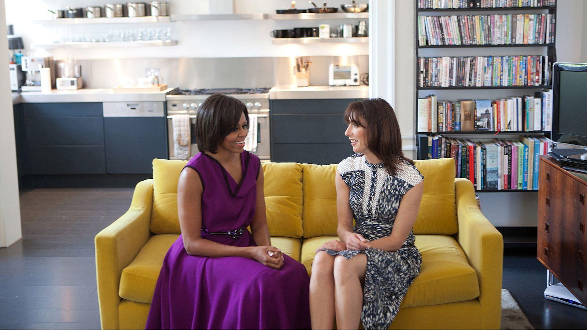 Michelle Obama and Samantha Cameron, partner of David Cameron, talk before having tea at Downing Street - Credit: Getty Images