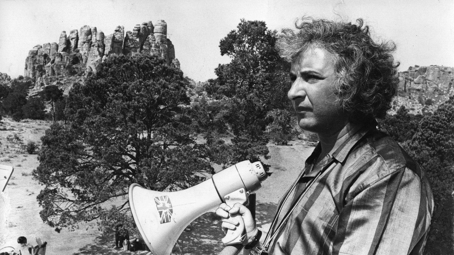 Michael Winner, on location in Cambridge, directing The Nightcomers. The 1971 film starred Marlon Brando - Credit: Getty Images