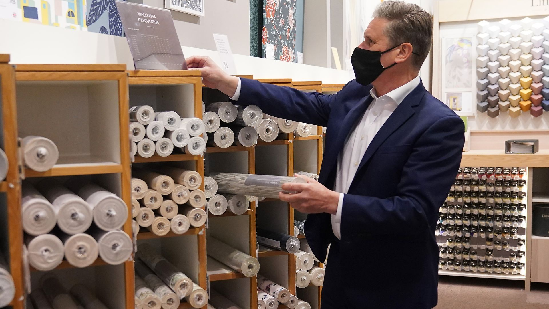 Labour Party leader Sir Keir Starmer browses through the wallpaper section at John Lewis - Credit: PA