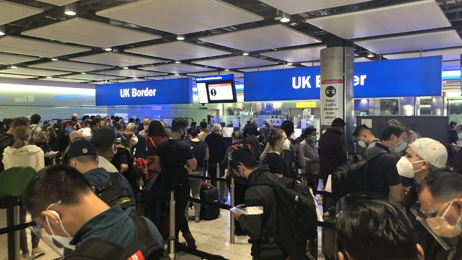 Dense crowds in the customs hall at Heathrow - Credit: Geoff McDonald